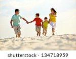 photo of happy family running... | Shutterstock . vector #134718959