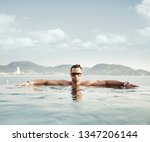 young muscular man on a... | Shutterstock . vector #1347206144