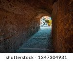 gate on the wall of tarragona.... | Shutterstock . vector #1347304931