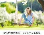 cute little girl having fun on... | Shutterstock . vector #1347421301