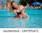 mother and baby in swimming... | Shutterstock . vector #1347591671