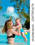 mother and baby in swimming... | Shutterstock . vector #1347591674