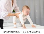young mother teaches a little... | Shutterstock . vector #1347598241