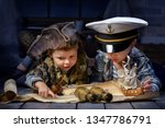 Two boys, a pirate and a sailor, played in a naval battle in his room