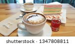hot latte coffee in white cup... | Shutterstock . vector #1347808811