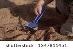 hands of baby play with sand on ... | Shutterstock . vector #1347811451