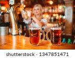 two glasses of fresh beer on... | Shutterstock . vector #1347851471