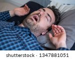 man with snoring problem... | Shutterstock . vector #1347881051