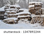 Wood And Palets Under The Snow...