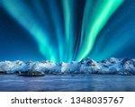 Aurora Borealis Above The Snow...