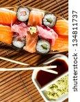 fresh sushi rolls on bamboo mat | Shutterstock . vector #134811737