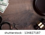 Handcuffs Gavel And Money On...