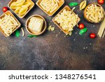 various pasta on wooden bowls... | Shutterstock . vector #1348276541