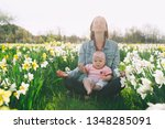 beautiful loving mother and... | Shutterstock . vector #1348285091
