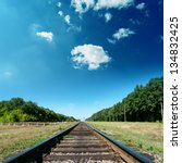 railroad to green horizon - stock photo
