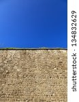 Small photo of Low angle view of part of a stone wall, located at the old city of Acco, Israel.