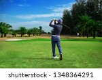 Small photo of Golfer hitting golf shot with club on course vintage color tone, Man playing golf on a golf course in the sun, Golfers hit sweeping golf course in the summer