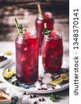 Stock photo hibiscus ice tea with lime lemongrass green tea and honey 1348370141