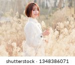 beautiful young brunette woman... | Shutterstock . vector #1348386071