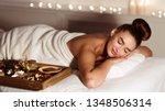 young woman relaxing in beauty... | Shutterstock . vector #1348506314