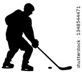 silhouette of hockey player.... | Shutterstock .eps vector #1348544471