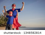 father and son playing... | Shutterstock . vector #1348582814