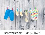 Stock photo baby clothes hanging on the clothesline 134864624