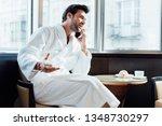 happy bearded man in white... | Shutterstock . vector #1348730297