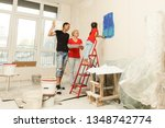 young family doing a home... | Shutterstock . vector #1348742774