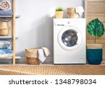 Stock photo interior of a real laundry room with a washing machine at home 1348798034