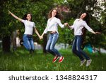 three friends jumping for joy... | Shutterstock . vector #1348824317