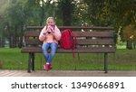 happy schoolgirl with rucksack... | Shutterstock . vector #1349066891