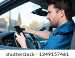 man driving car and texting on... | Shutterstock . vector #1349157461