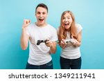 excited young couple  a guy and ... | Shutterstock . vector #1349211941