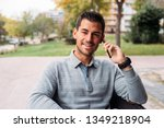 young man sitting in a chair in ... | Shutterstock . vector #1349218904