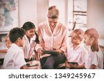 teacher teaching kids on...   Shutterstock . vector #1349245967