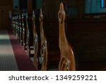 Rows of Old Brown Wooden Pews inside a Catholic Church Cathedral