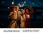 group of friends having fun at... | Shutterstock . vector #1349317037