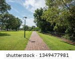 brick footpath with lush... | Shutterstock . vector #1349477981
