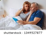 Small photo of Message from swindler. Grey-haired husband feeling terrified after getting message from swindler