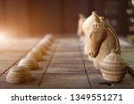 wooden chess on wooden board.... | Shutterstock . vector #1349551271
