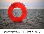 Red Swim Ring On The Beach...