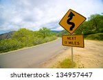 Winding Road Sign Warns Of...