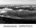 horse on a mountain over a sea... | Shutterstock . vector #1349673311