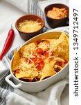 baking dish with tasty nachos ... | Shutterstock . vector #1349712497