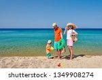 family on beach wearing straw... | Shutterstock . vector #1349908274