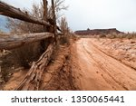 Sandy Dirt Road Next To Rustic...