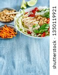 chicken with salad on a blue... | Shutterstock . vector #1350119921