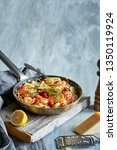 pasta dish eith tomatoes and... | Shutterstock . vector #1350119924
