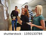 diverse group of colleagues... | Shutterstock . vector #1350133784